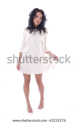 Cute young woman in white dress