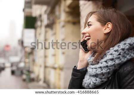 Cute young woman is communicating on telephone