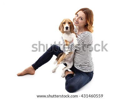 Cute young woman is embracing her dog - stock photo