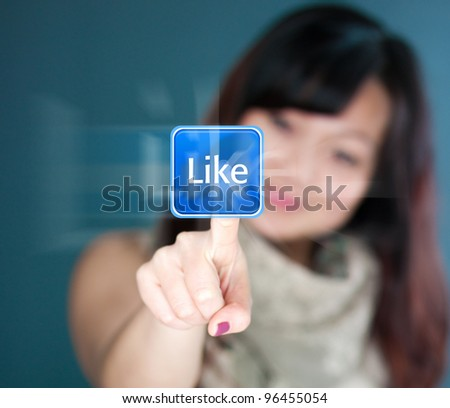 Cute young woman is touching the like button - stock photo