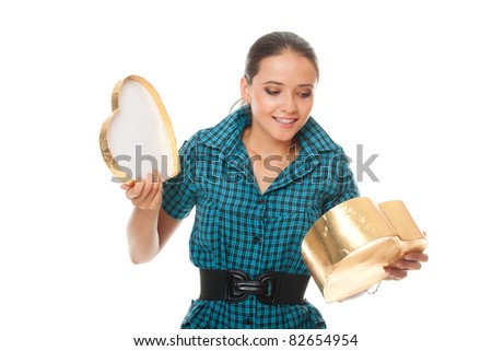 cute young woman looking into gold  box gift as heart isolated on white background - stock photo