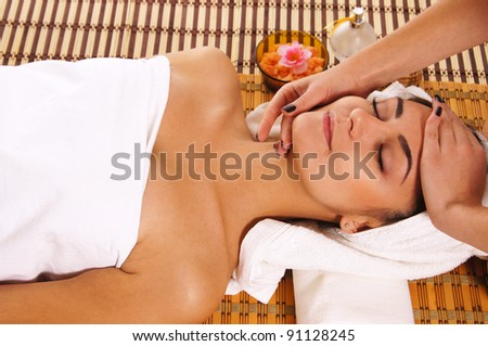 cute young woman lying at spa massage - stock photo
