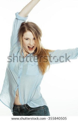 cute young woman making cheerful faces on white background, messed hair isolated smiling - stock photo