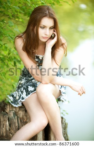 cute young woman park talking phone smiling