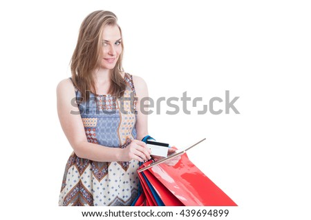 Cute young woman shopping online with credit card and tablet pc looking satisfied isolated on white with copy space - stock photo