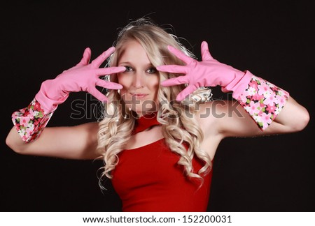 cute young woman wearing pink latex gloves ready for cleaning - stock photo