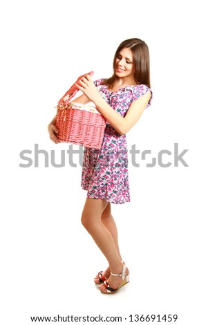Cute young woman with a laundry basket on a white background