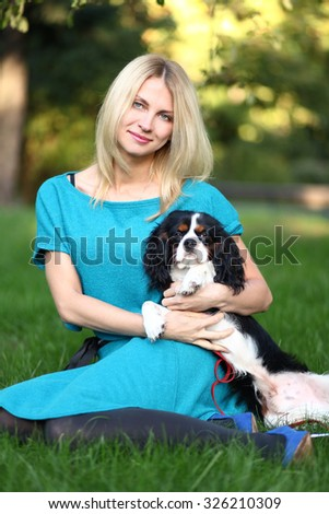 cute young woman with dog  in park