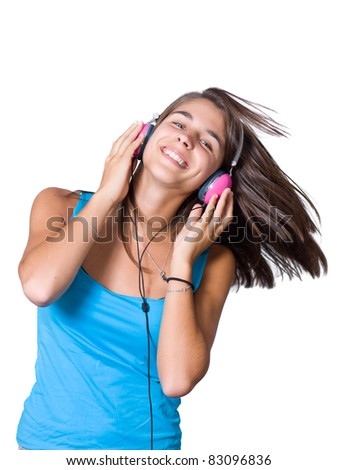 Cute young woman with headphones dancing on music - stock photo