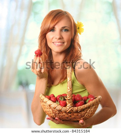 cute young woman with strawberry - stock photo