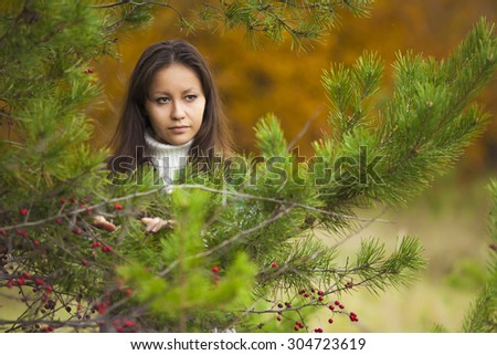 Cute young women in green forest