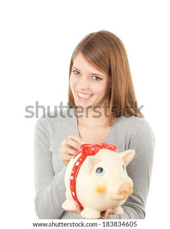 Cute young women with a piggy bank, studio shot isolated on white