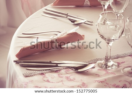 cutlery and napkin on the wedding table - colorized photo - stock photo