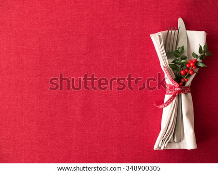 Cutlery kitchenware on  red tablecloth background food concept - stock photo