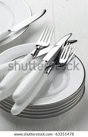 Cutlery  knife fork realistic on dish - stock photo