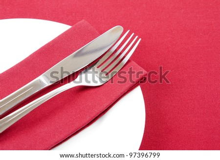 Cutlery on red napkin