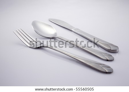Cutlery set consisting of fork,spoon and a knife. - stock photo