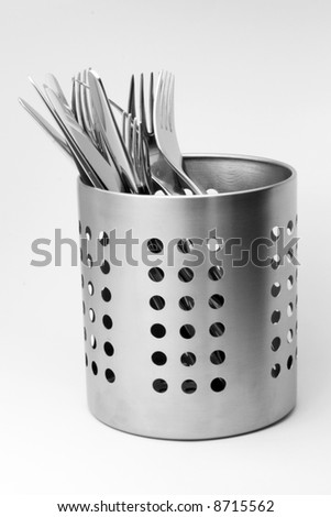 Cutlery set in a luxury aluminum stand. - stock photo