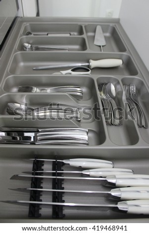 cutlery set, kitchen utensils drawer  - stock photo