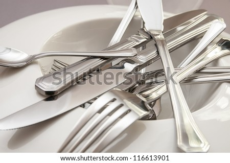 Cutlery set of metal spoons forks and knives