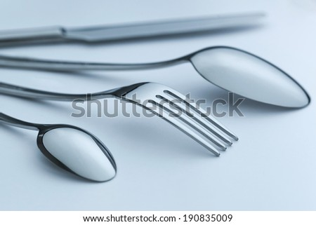 Cutlery set on light background, Silverware set of fork, spoons and knife - stock photo