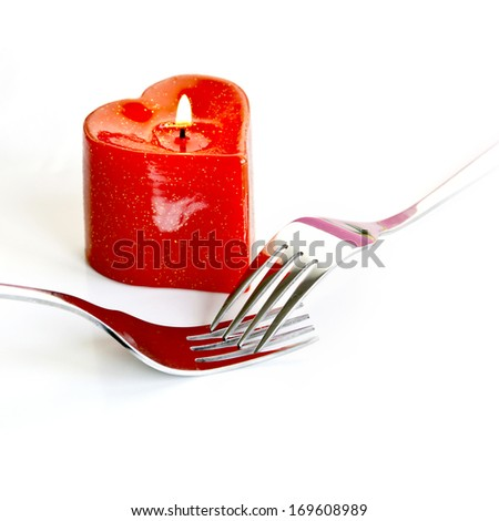 Cutlery Set with Candle - stock photo