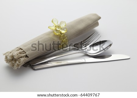 cutlery set with rolled napkin and holder - stock photo