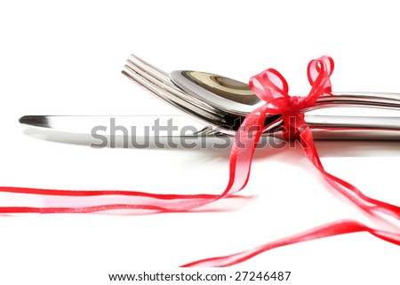 cutlery with romantic red ribbon - stock photo