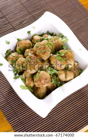 Cutlets and basil - stock photo