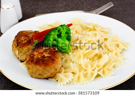 Cutlets with Pasta and Broccoli Studio Photo