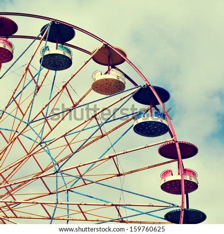 cutout of a Ferris wheel over the sky, with a retro effect - stock photo