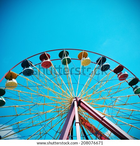 cutout of a vintage Ferris wheel over the sky, with a retro effect - stock photo
