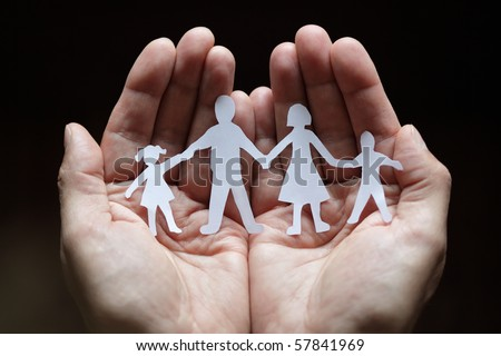 Cutout paper chain family with the protection of cupped hands, concept for security and care - stock photo