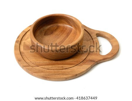 Cutout wooden bowl on a wooden chopping board.  - stock photo