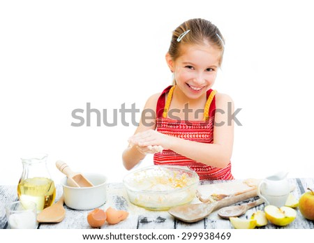cutre little girl making dough isolated on a white background - stock photo