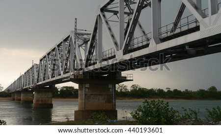 CUTTACK, INDIA - 25 MAY, 2016: A beautiful railway bridge over river.