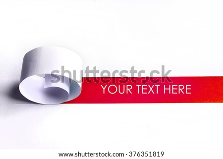 Cutted and rolled white paper with red space for text - stock photo