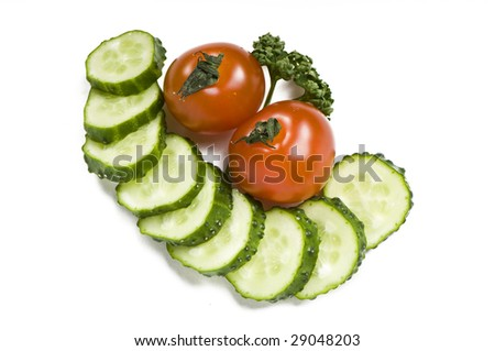 Cutted cucumber, parsley and tomatoes on white