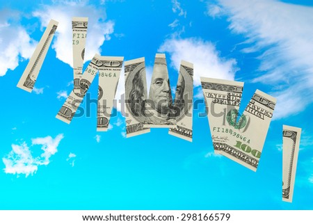 Cutted dollar banknote- money financial concept isolated on blue sky with clouds background - stock photo