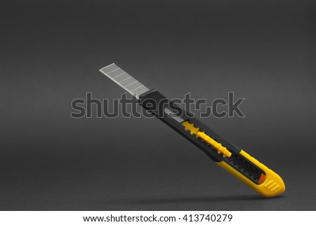 Cutter for paper photographed on a black background - stock photo
