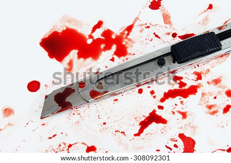 Cutter knife stained with blood on a white background.