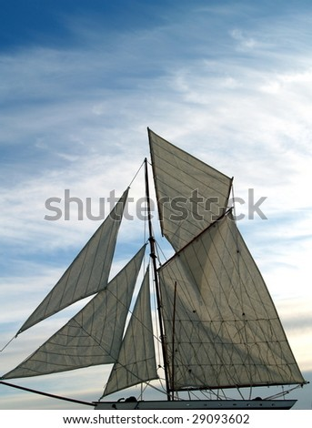 Cutter moves against a blue sky highlighted by stratus cloud - stock photo