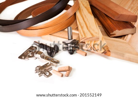 Cutters for wood, hinges for doors, edging, wooden dowels - stock photo