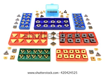 cutters in colorful boxes, metal and golden lathe tools for heavy industry on white background - stock photo