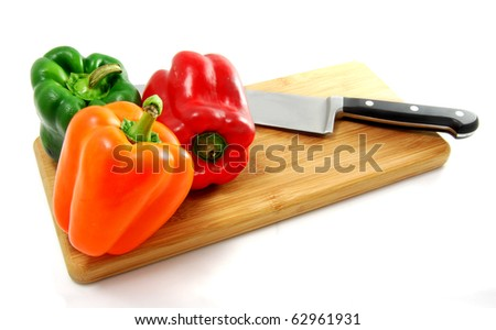 Cutting and Preparing Bell Peppers on Cutting Board including Red, Orange, and Green. Great ingredient for fajitas. - stock photo