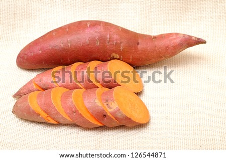 cutting and whole sweet potatoes on burlap