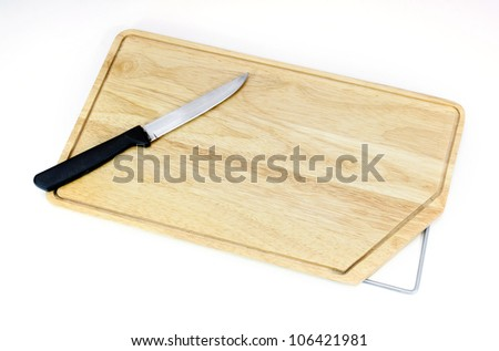 Cutting board and a knife isolated on white