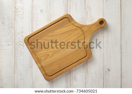 cutting board at white plank wooden background texture