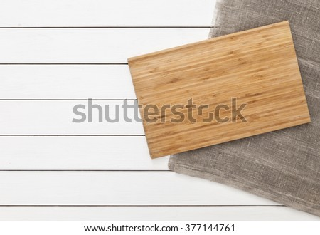 Cutting board on table. Top view - stock photo