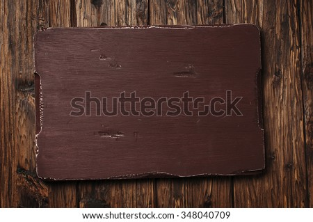 Cutting board on the vintage wooden background, selective focus